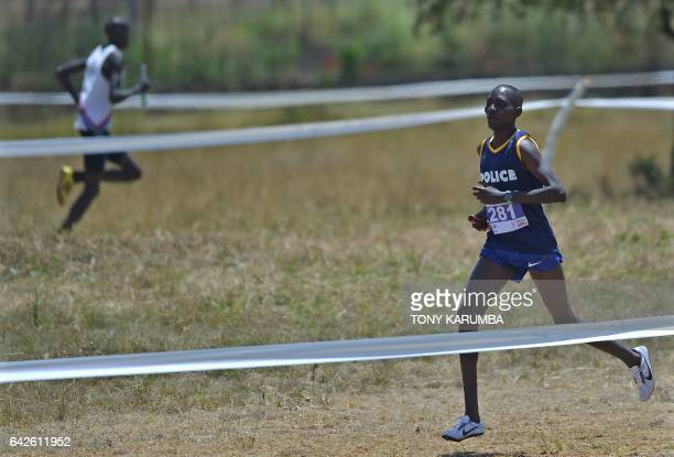 World 1500m champion Asbel Kiprop runs to win the crosscountry mixed relays for the Kenya Police team on February 18 2017 in the Kenyan capital...