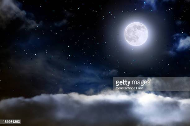 world above clouds - moonlight stock pictures, royalty-free photos & images
