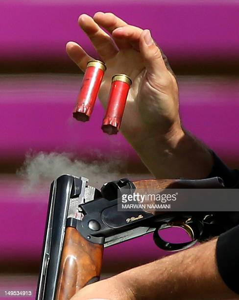World and Olympic record holder Vincent Hancock of the United States catches empty cartridges as he competes in the men's skeet qualification at The...