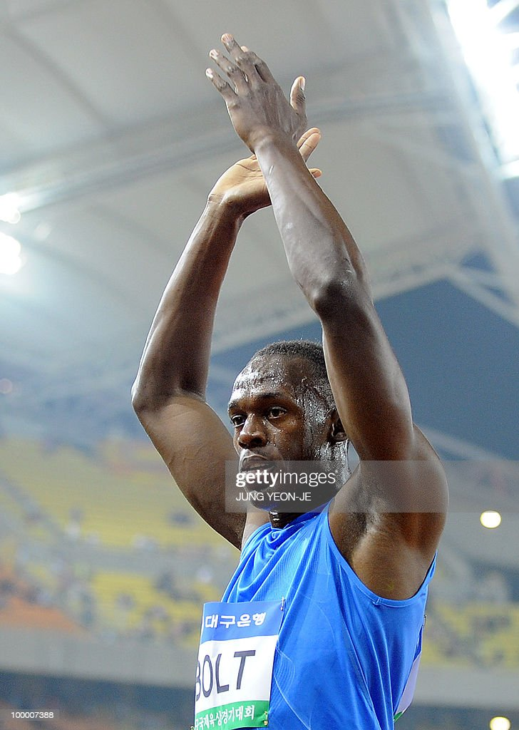 World and Olympic triple gold medallist Usain Bolt from Jamaica celebrates after the men's 100 meter event of the Daegu Pre-Championships Meeting in Daegu, southeast of Seoul, on May 19, 2010. Bolt won the event with a time of 9.86 seconds.