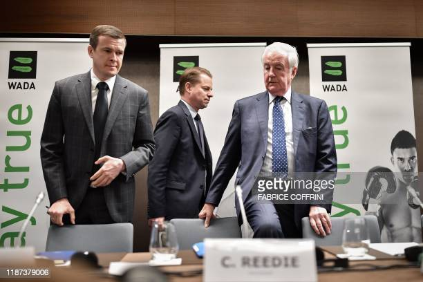 World Anti-Doping Agency President-Elect Witold Banka, WADA Director General Olivier Niggli and WADA President Craig Reedie arrive for a press...