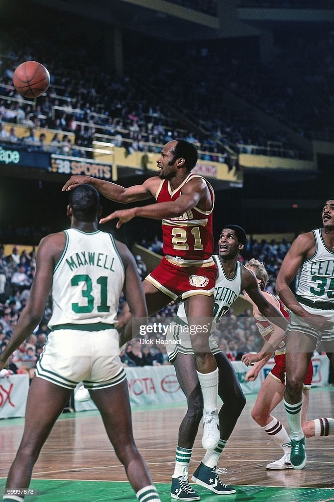 World B. Free #21 of the Cleveland Cavaliers passes against the Boston Celtics during a game played in 1983 at the Boston Garden in Boston, Massachusetts.