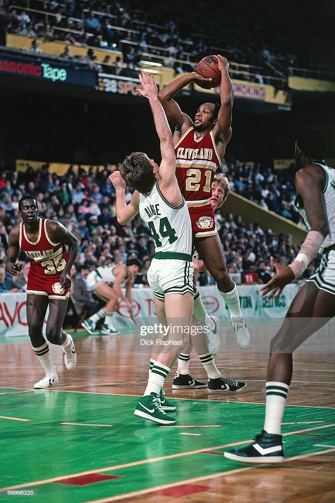 World B. Free #21 of the Cleveland Cavaliers shoots against Danny Ainge #44 of the Boston Celtics during a game played in 1983 at the Boston Garden in Boston, Massachusetts.