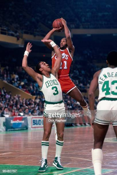 World B Free of the Cleveland Cavaliers shoots over Dennis Johnson of the Boston Celtics during a game played in 1984 at the Boston Garden in Boston...