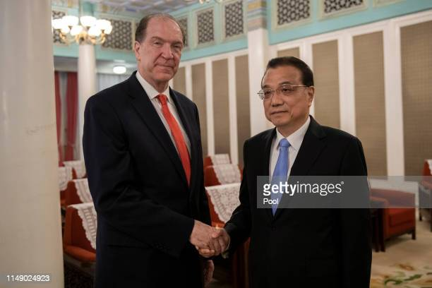World Bank chairman David Malpass and Chinese Premier Li Keqiang shake hands at Zhongnanhai in Beijing on June 11 2019