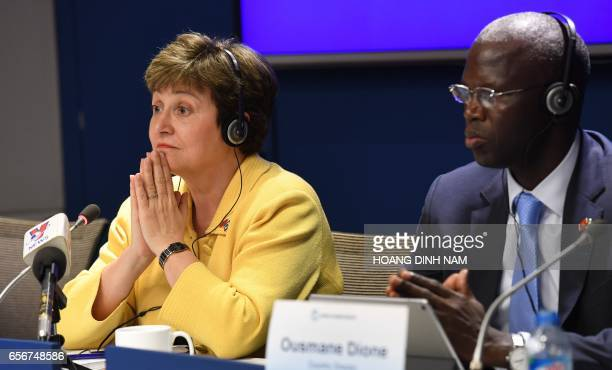 World Bank chief executive officer Kristalina Georgieva listens to questions with World Bank country director for Vietnam Ousmane Dione during a...