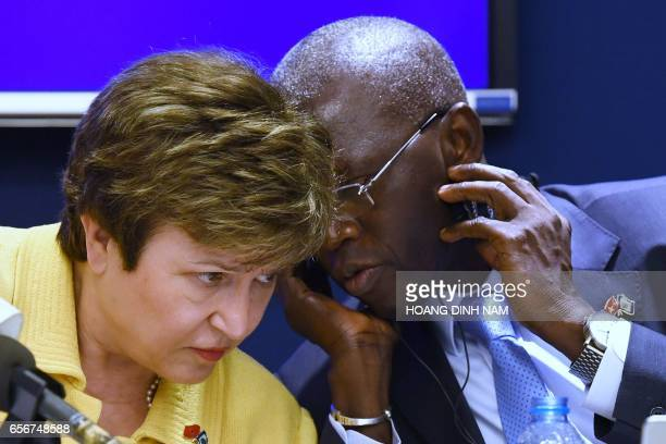 World Bank chief executive officer Kristalina Georgieva listens to World Bank country director for Vietnam Ousmane Dione during a press conference on...