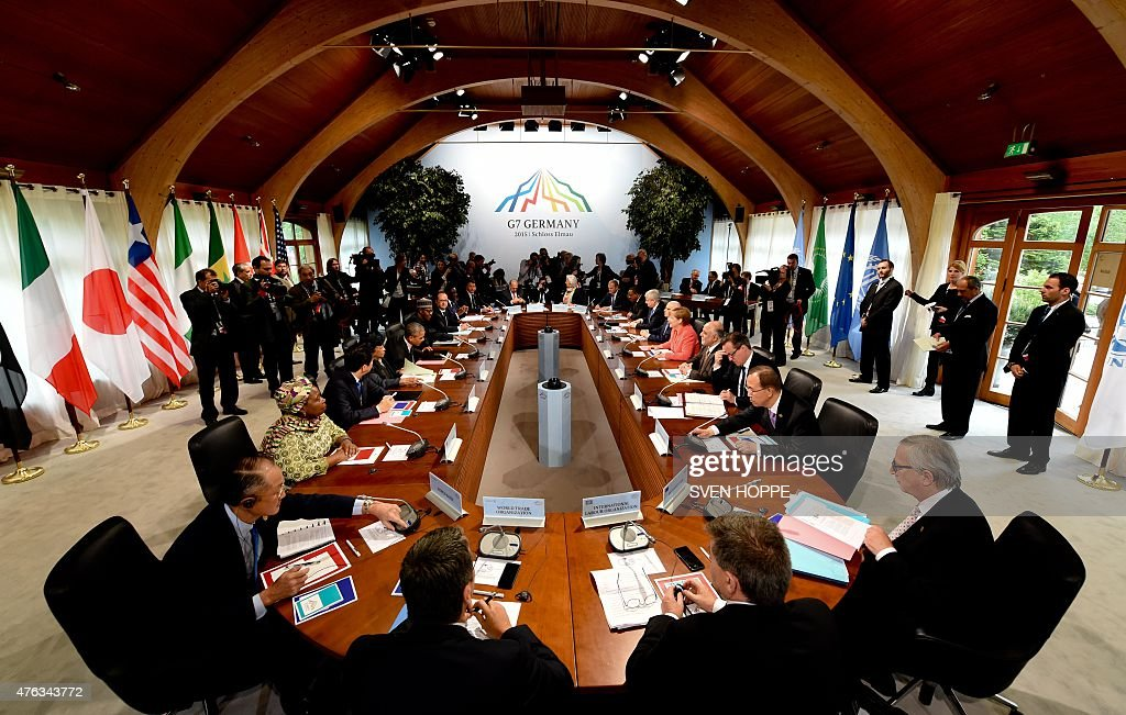World Bank Group President Jim Kim, Chair of the Commission of the African Union Dlamini Zuma, Japanese Prime Minister Shinzo Abe, Liberia's President Ellen Johnson Sirleaf, US President Barack Obama, Nigerian President Muhammadu Buhari, French President Francois Hollande, Senegal's President Macky Sall, Italy's Prime Minister Matteo Renzi, OECD secretary general Jose Angel Gurria, IMF Managing Director Christine Lagarde, President of the European Council Donald Tusk, Ethiopia's Prime Minister Hailemariam Desalegn, Canada's Prime Minister Stephen Harper, Tunisia's President Beji Caid Essebsi, Germany's Chancellor Angela Merkel, Iraq's Prime Minister Haider al-Abadi, British Prime Minister David Cameron, United Nations Secretary-General Ban Ki-moon and European Union Commission President Jean-Claude Juncker attend the so called 'outreach meeting' on the second day of the G7 summit at the Elmau Castle near Garmisch-Partenkirchen, southern Germany, on June 8, 2015.