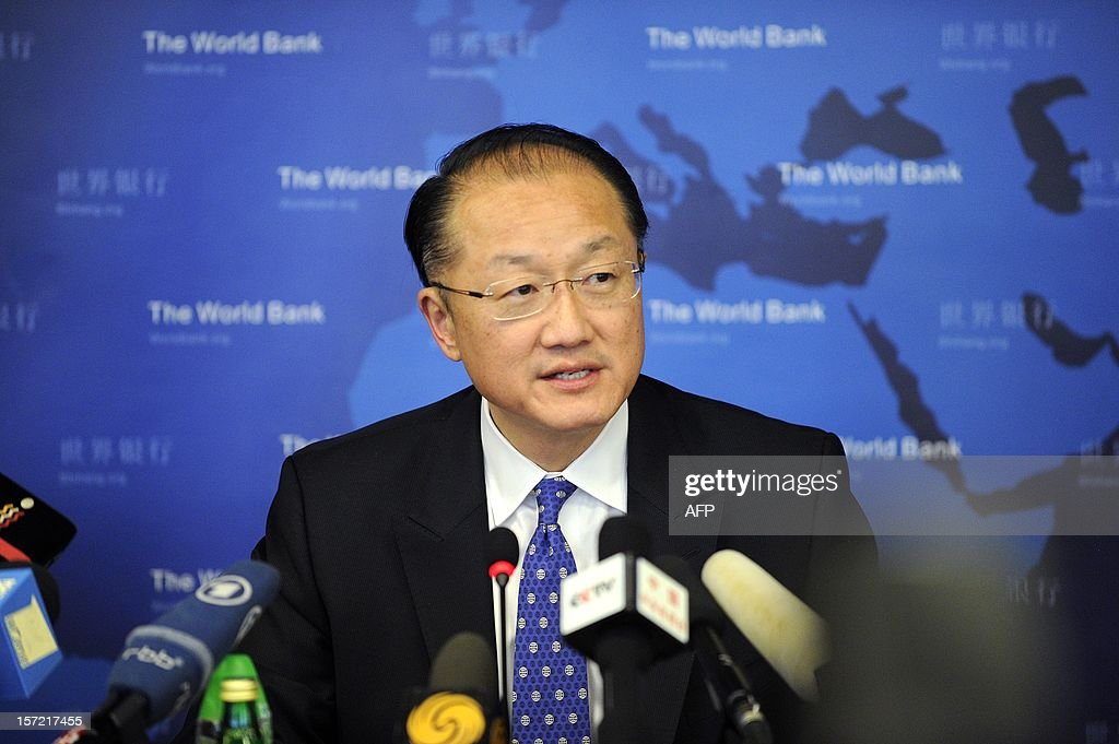 World Bank Group President Jim Yong Kim answers a question at a press conference in Beijing on November 30, 2012. The World Bank is to launch a joint study with Beijing on urbanisation in China, one of the great human migrations of modern times, it said on November 30.
