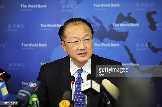 World Bank Group President Jim Yong Kim answers a question at a press conference in Beijing on November 30 2012 The World Bank is to launch a joint...