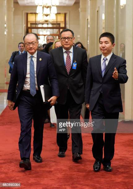 World Bank Group President Jim Yong Kim attends a meeting with Chinese Premier Li Keqiang at the Great Hall of the People in Beijing on May 14, 2017....