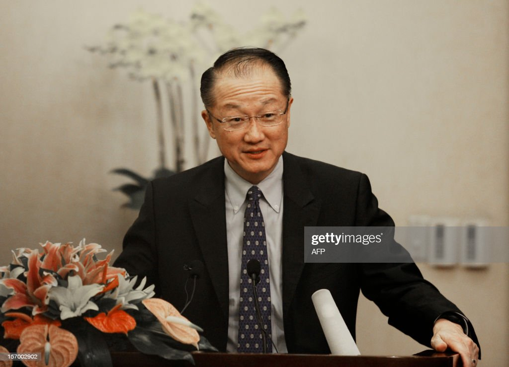 World Bank Group President Jim Yong Kim delivers a speech at a signing ceremony in Beijing on November 27, 2012. Jim Yong Kim started his first visit to China as Worldbank president on November 27 by signing an agreement with the Chinese government to launch a new knowledge platform to improve urban transport, focusing on low-carbon emissions, as China's fast growing cities are among the most polluted in the world.