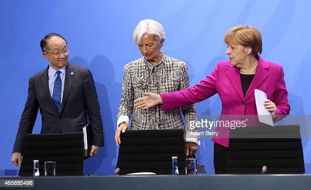 World Bank Group President Jim Yong Kim International Monetary Fund Managing Director Christine Lagarde and German Chanceller Angela Merkel attend a...