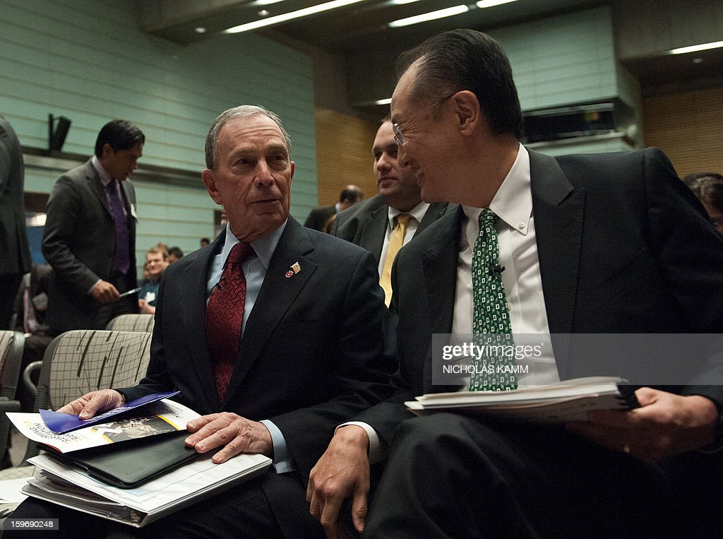 World Bank President Jim Yong Kim (R) and New York City mayor Michael Bloomberg attend the annual Transforming Transportation conference at the World Bank in Washington,DC on January 18, 2013. AFP PHOTO/Nicholas KAMM