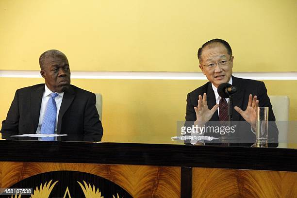 World Bank President Jim Yong Kim gestures as he addresses a press conference flanked by Ghana's Vice President Kwesi AmissahArthur in Accra on...