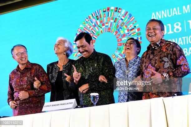 TOPSHOT World Bank President Jim Yong Kim International Monetary Fund chief Christine Lagarde Indonesia's Coordinating Minister for Maritime Affairs...