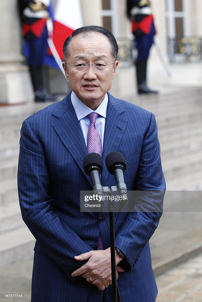 World bank president Jim Yong Kim makes a statement after a meeting with French President Francois Hollande and leaders of the world organizations linked to G20 at the Elysee presidential Palace on November 8, 2013 in Paris.The rating of France's sovereign debt has been downgraded for the second time in two years, as ratings agency Standard and Poor's cut the nation's credit rating from AA+ to AA.