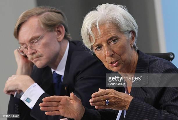 World Bank President Robert Zoellick and International Monetary Fund Director Christine Lagarde speak to the media following talks among world...