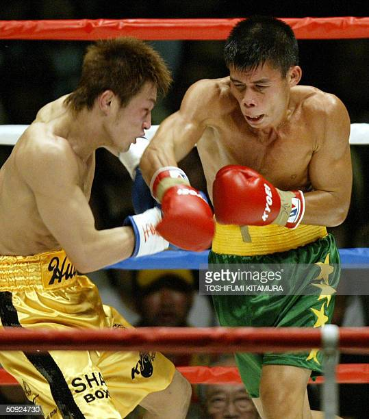 World Boxing Association featherweight champion Chris John of Indonesia punches challenger Osamu Sato of Japan during their title bout in Tokyo 04...