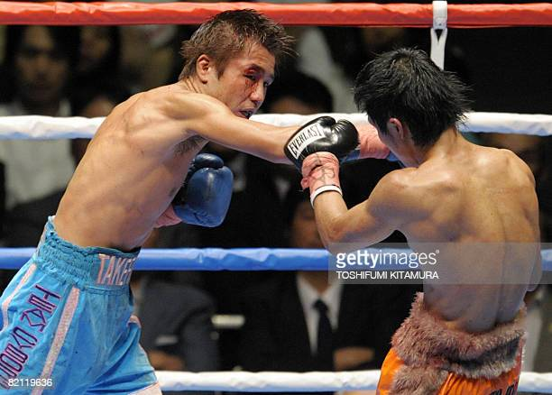 World Boxing Association flyweight champion Takefumi Sakata punches challenger Hiroyuki Hisataka during their title bout in Tokyo on July 30 2008...