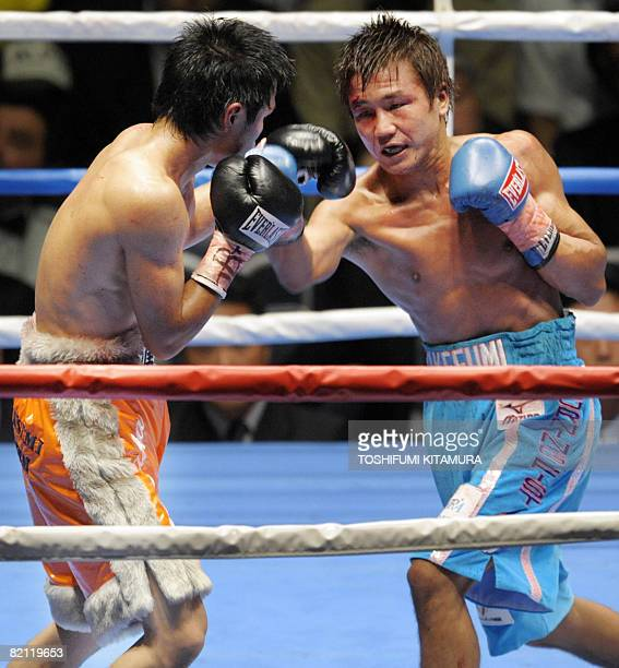 World Boxing Association flyweight champion Takefumi Sakata punches challenger Hiroyuki Hisataka during their title bout in Tokyo on July 30 2008...