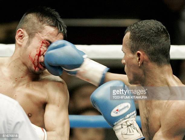 "World Boxing Association minimum-weight ""interim"" champion Juan Landaeta of Venezuela punches defending champion Yutaka Niida of Japan during their..."