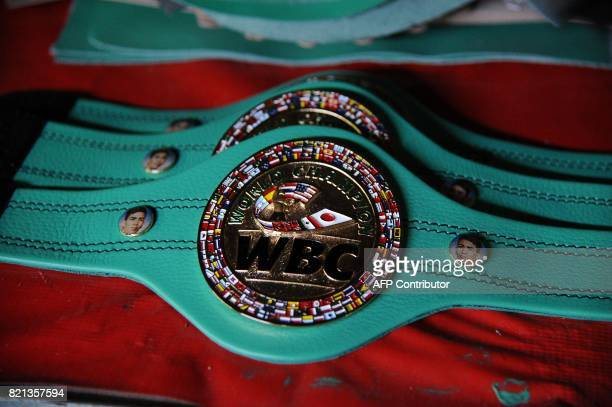World Boxing Council belts made at Reyes Industries are displayed at the company's headquarters in Mexico city on July 06 2017 Cleto Reyes' gloves...