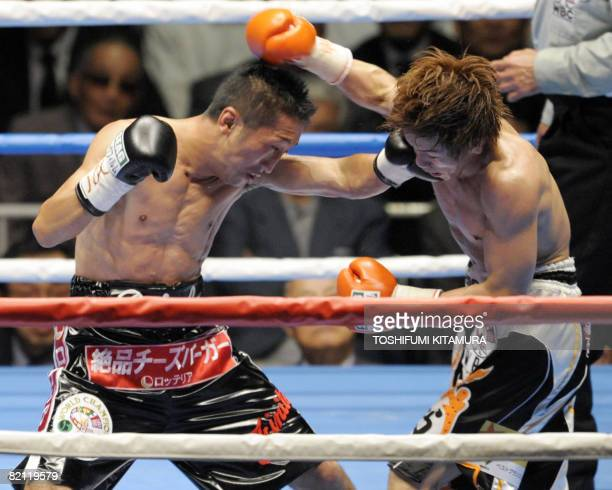 World Boxing Council flyweight champion Daisuke Naito punches challenger Tomonobu Shimizu during the 7th round of their title bout in Tokyo on July...