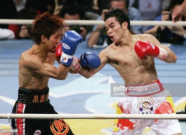 World Boxing Council flyweight champion Pongsaklek Wonjongkam of Thailand punches Japanese challenger Noriyuki Komatsu during their title bout in...