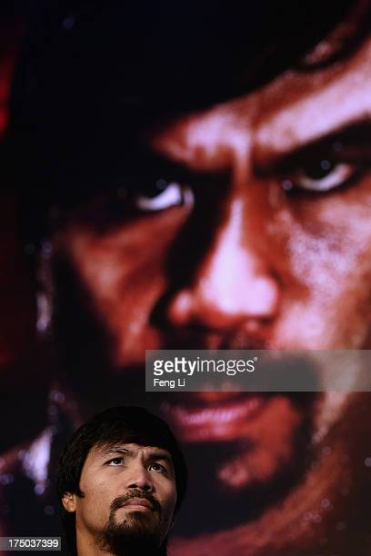 World boxing icon Manny Pacquiao attends a press conference on July 30 2013 in Beijing China Pacquiao will fight with Rios in a welterweight bout at...