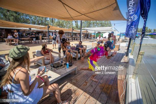 World Champion Adriano de Souza warms up before his heat while spectators watch and attempt to stay cool on finals day during the Jeep Surf Ranch Pro...