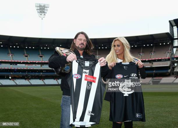 S world champion AJ Styles and Smackdown women's champion Carmella pose for photos as they are presented with football jumpers at the Melbourne...