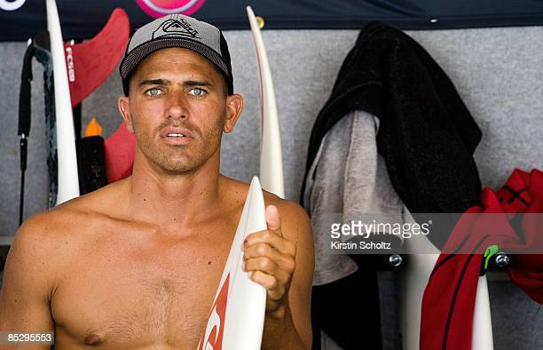 World Champion and defending Quiksilver Pro Champion Kelly Slater of the United States of America watches the surfing from the competitors area while...