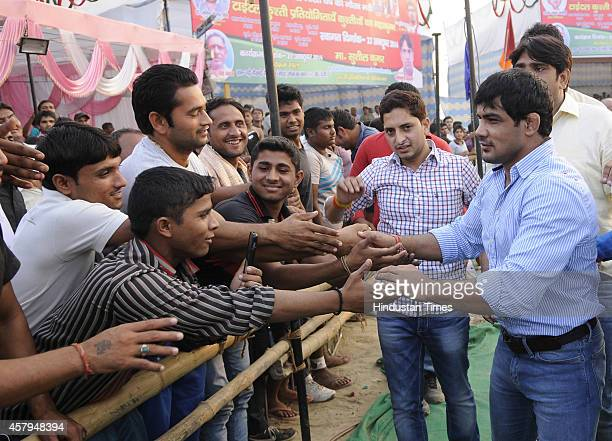 World Champion and Olympic medal winner wrestler Sushil Kumar meeting with people during Wrestling Title Championship at Gari Chaukhandi village on...