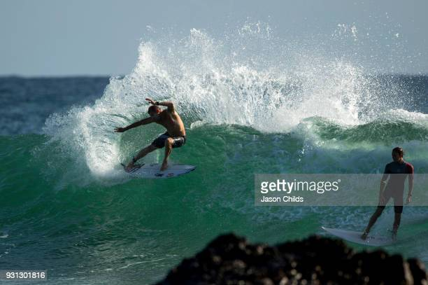 3X World Champion Australian Mick Fanning glides through the waves while practicing for his upcoming round 3 heat at Snapper Rocks Coolangatta for...