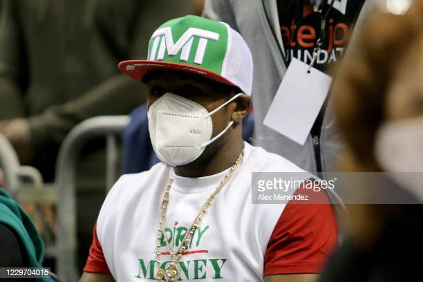 World champion boxer Floyd Mayweather Jr. Wears a face mask as he sits ringside during the Fight Night in Daytona Beach boxing event at the Ocean...