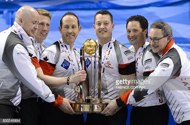 World Champion Canada's team members skip Kevin Koe third Marc Kennedy second Brent Laing lead Ben Hebert alternate Scott Pfeifer and coach John Dunn...