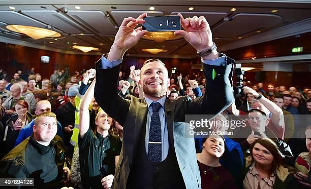 IBF world champion Carl Frampton takes a selfie on a smart phone after the WBA and IBF superbantamweight world title unification prefight press...