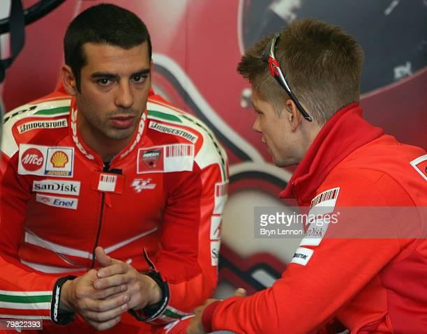 World Champion Casey Stoner of Australia and the Ducati Marlboro Team chats to team mate Marco Melandri during MotoGP Testing at the Circuito de...