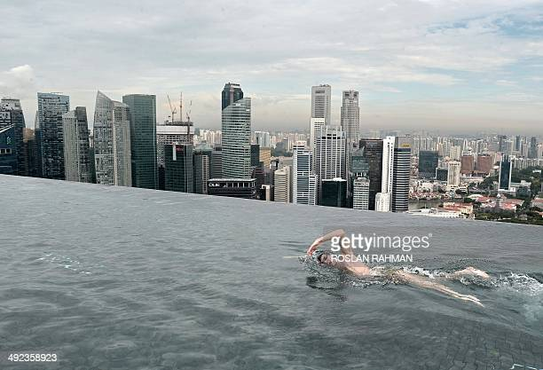 World Champion Christian Sprenger of Australia swims during a swimming clinic session for children with special needs on the rooftop pool of the...