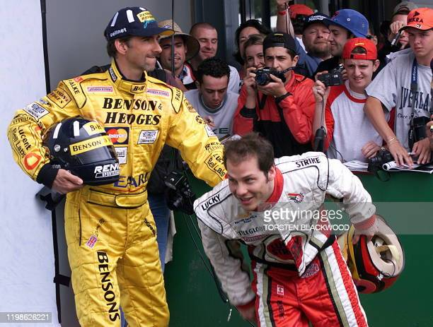 World champion Damon Hill of Great Britain pushes 1997 world champion Jacques Villeneuve of Canada out of the way during the drivers' photo session...