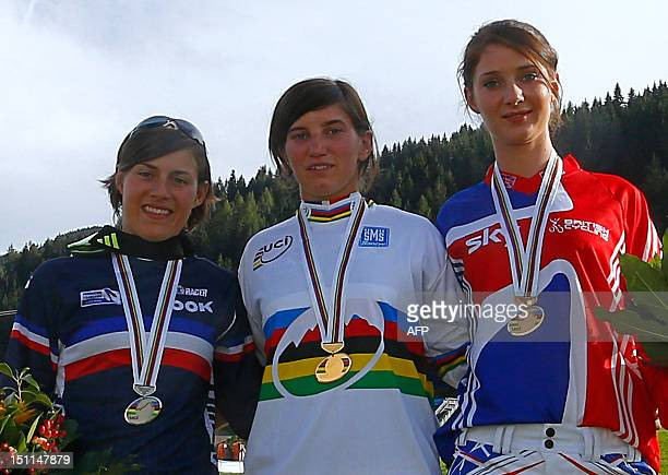 World champion French Morgane Charre France's Emmeline Ragot and Great Britain's Manon Carpenter poses with their medals after competing in the...