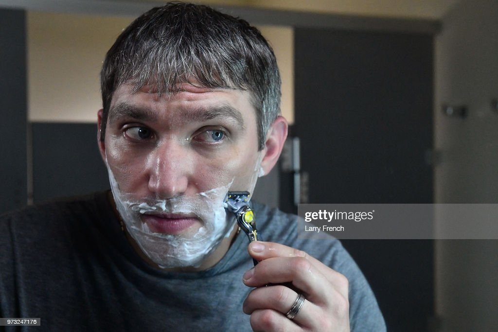 World Champion hockey star Alex Ovechkin shaves his 'playoff beard' with the Gillette Fusion ProShield Razor during an official Gillette Shave event on June 13, 2018 in Mclean, Virginia.