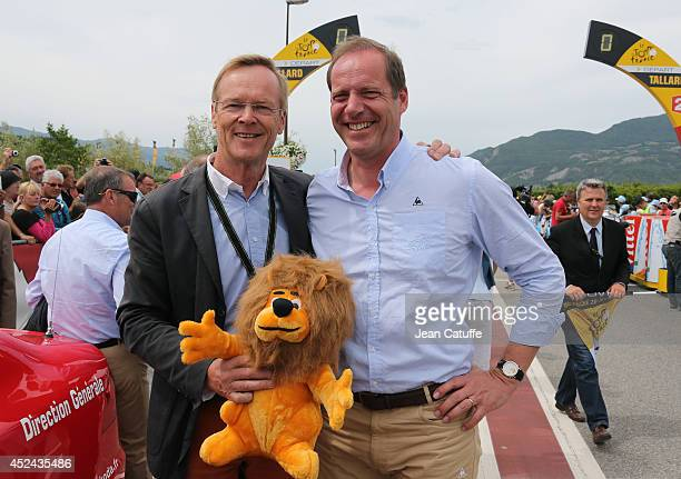 World champion in rally and four times winner of ParisDakar Ari Vatanen of Finland poses with director of the Tour de France Christian Prudhomme...