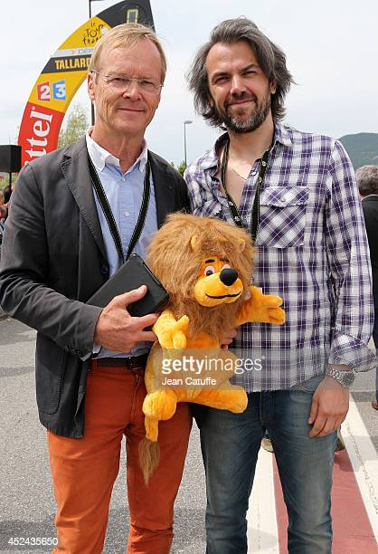 World champion in rally and four times winner of ParisDakar Ari Vatanen of Finland poses with french journalist Aymeric Caron before stage fifteen of...