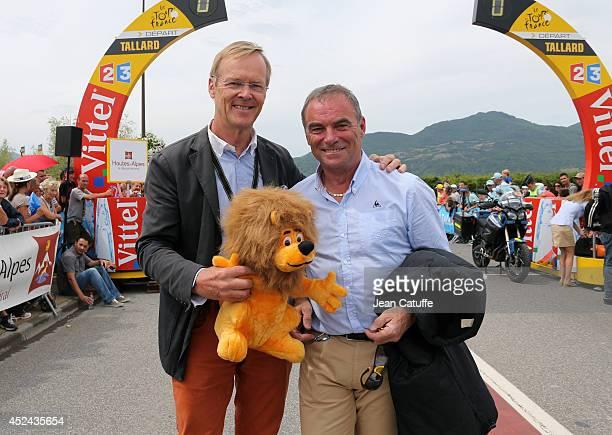 World champion in rally and four times winner of ParisDakar Ari Vatanen of Finland poses with five times winner of the Tour de France Bernard Hinault...
