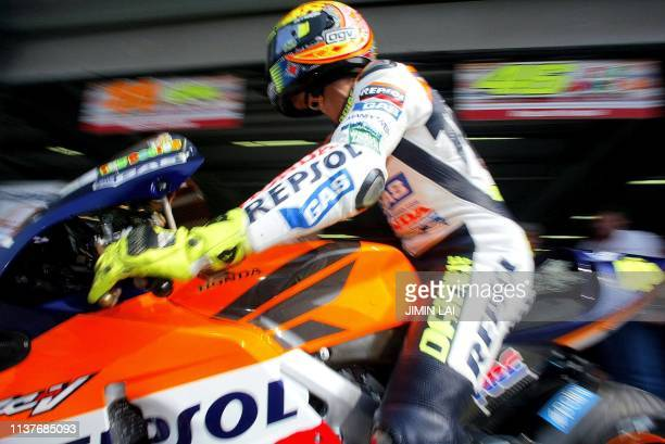 World Champion Italian rider Valentino Rossi of Repsol Honda leaves the pits of the Sepang International Circuit during the first practice session of...
