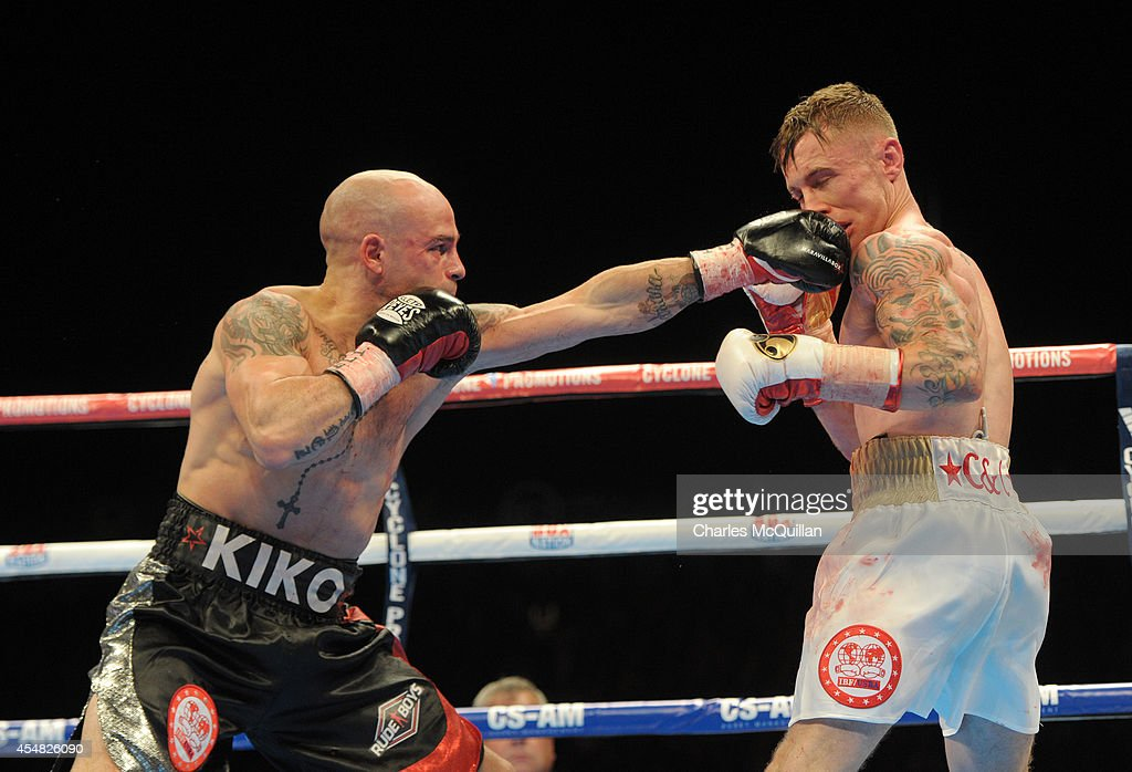 World champion Kiko Martinez of Spain lands a punch against Carl Frampton of Northern Ireland during their IBF super-bantamweight world title bout, at the purpose-built 16,000 capacity Titanic slipway outdoor arena on September 6, 2014 in Belfast, Northern Ireland. (Photo by Charles McQuillan/Getty Images).