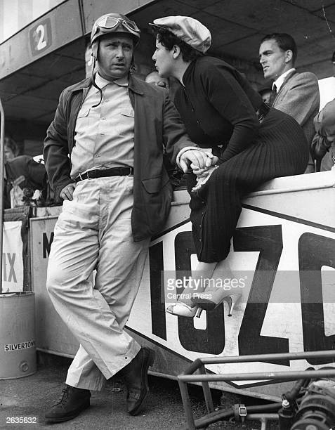World champion racing driver Juan Manuel Fangio with his partner Andrea at Silverstone for the 1954 British Grand Prix