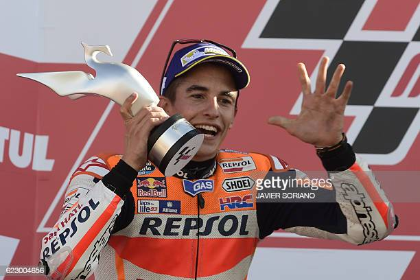 World Champion Repsol Honda Team's Spanish rider Marc Marquez celebrates on the podium after the MotoGP race of the Motul Comunidad Valenciana Grand...